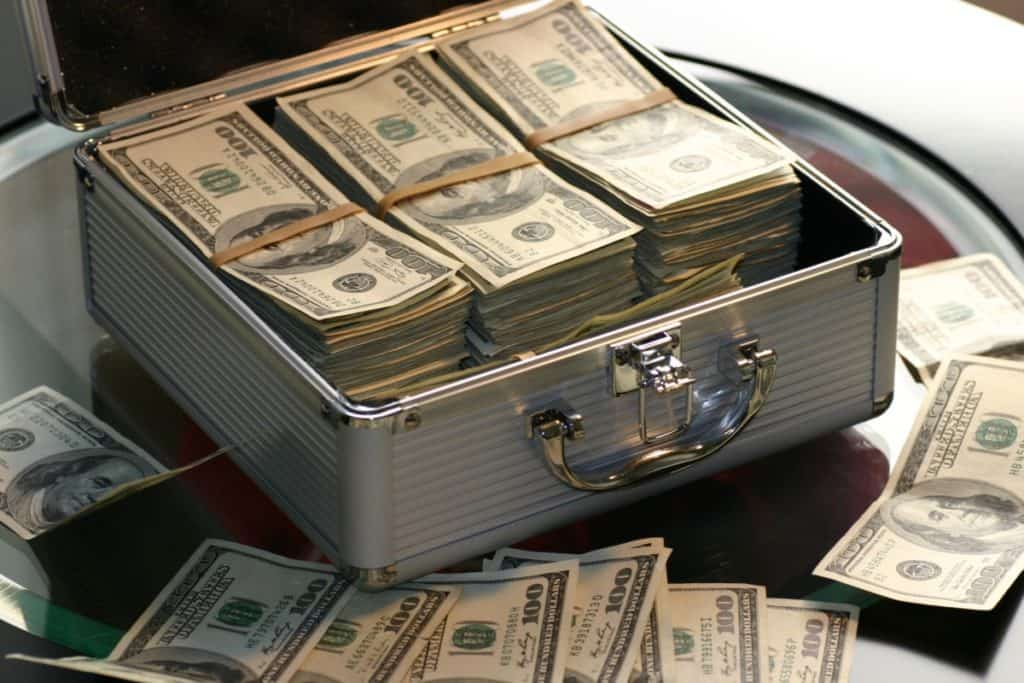 A case full of money sitting on a table.