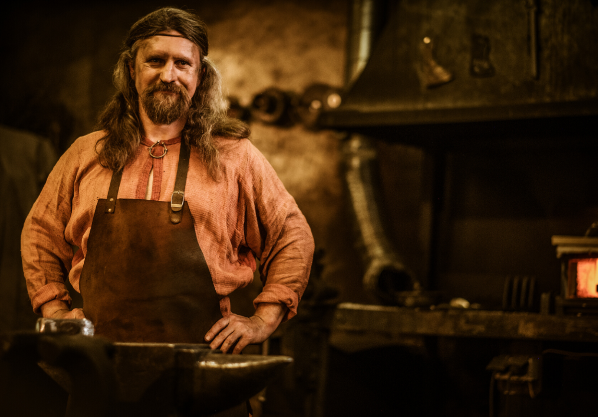 blacksmith working in his forge room.