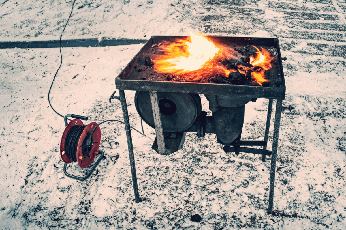 Blacksmith forge in the snow.