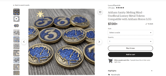 Metal coin tokens for a boardgame.